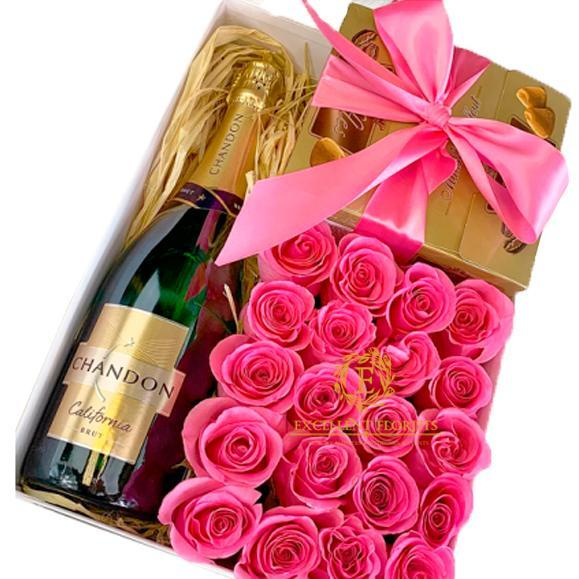 Gift box with flowers, chocolate and champage