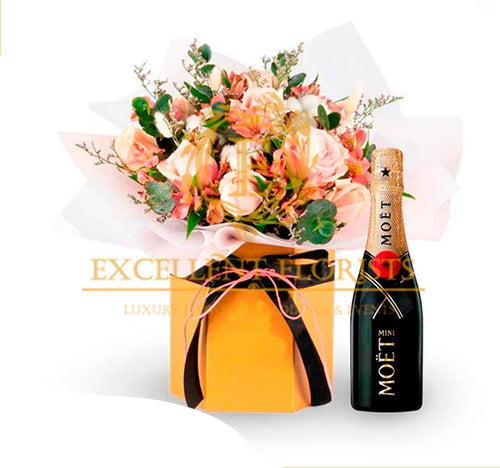 Pink roses, orchids, and Moet Champagne