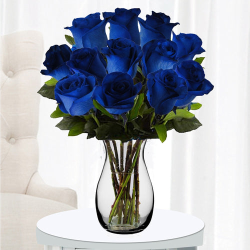 Dozen of Blue Roses in a vase