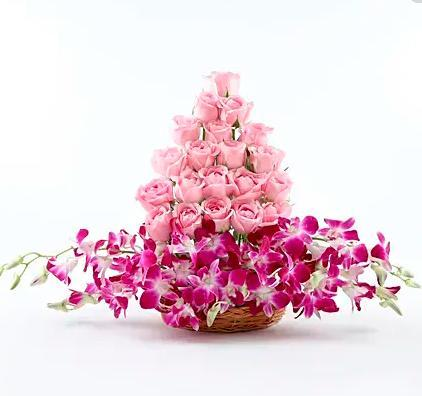 Pink Roses and Orchids in a basket