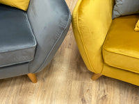 piped edged mustard and grey sofa