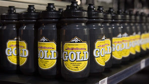 For The Riders gold water bottle