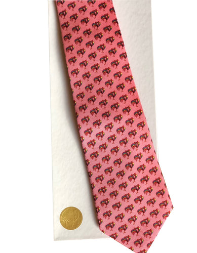 Custom designed pink silk tie by Pelican Coast depicted on white gift box with gold colored seal.