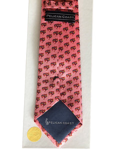 Back of the custom designed pink silk tie by Pelican Coast depicted on white gift box with gold colored seal.