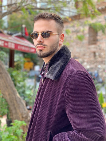 Man wearing vintage burgundy bomber jacket