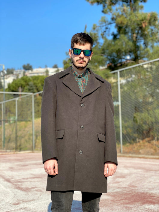 Man wearing a vintage cypress green coat