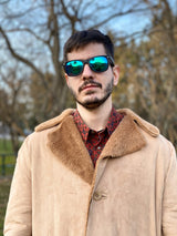 Man wearing a 80s fashion beige coat