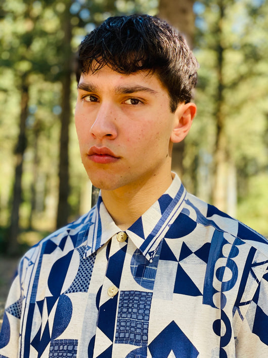 A man wearing a 1980s fashion geometric printed vintage shirt for men