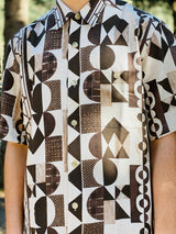 The abstract prints details consisted of multiple shapes in brown and white colors