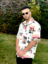 A male model in a garden wearing a 1980s vintage patterned shirt.