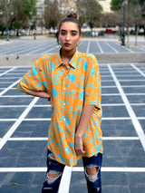 A female model wearing a unique patterned vintage shirt from the 1990s.
