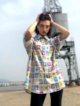 A female model at the docs, wearing a geometric printed vintage shirt from the 1990s.