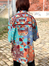 The back side of the vintage viscose shirt, with all over prints and multiple colors.