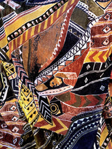 Details of the print consisted of multiple colors, shapes and figures  inspired by the jungle.