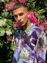 Male model wearing a cotton patterned vintage shirt from the 1990s, in front of flowers.