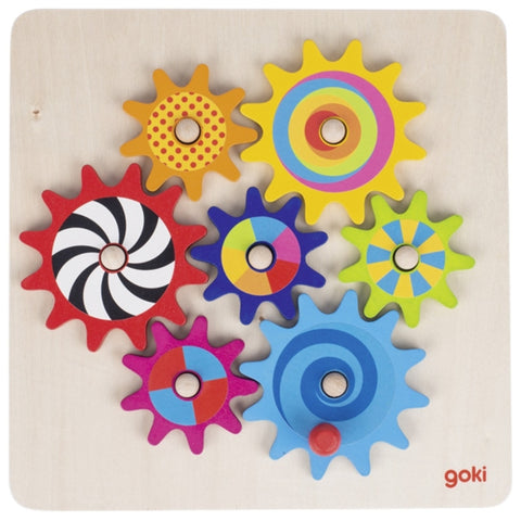 Colourful wooden cogs that fit together on a wooden tableau
