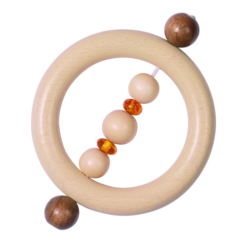 Circular wooden clutching toy, with wooden and amber beads.