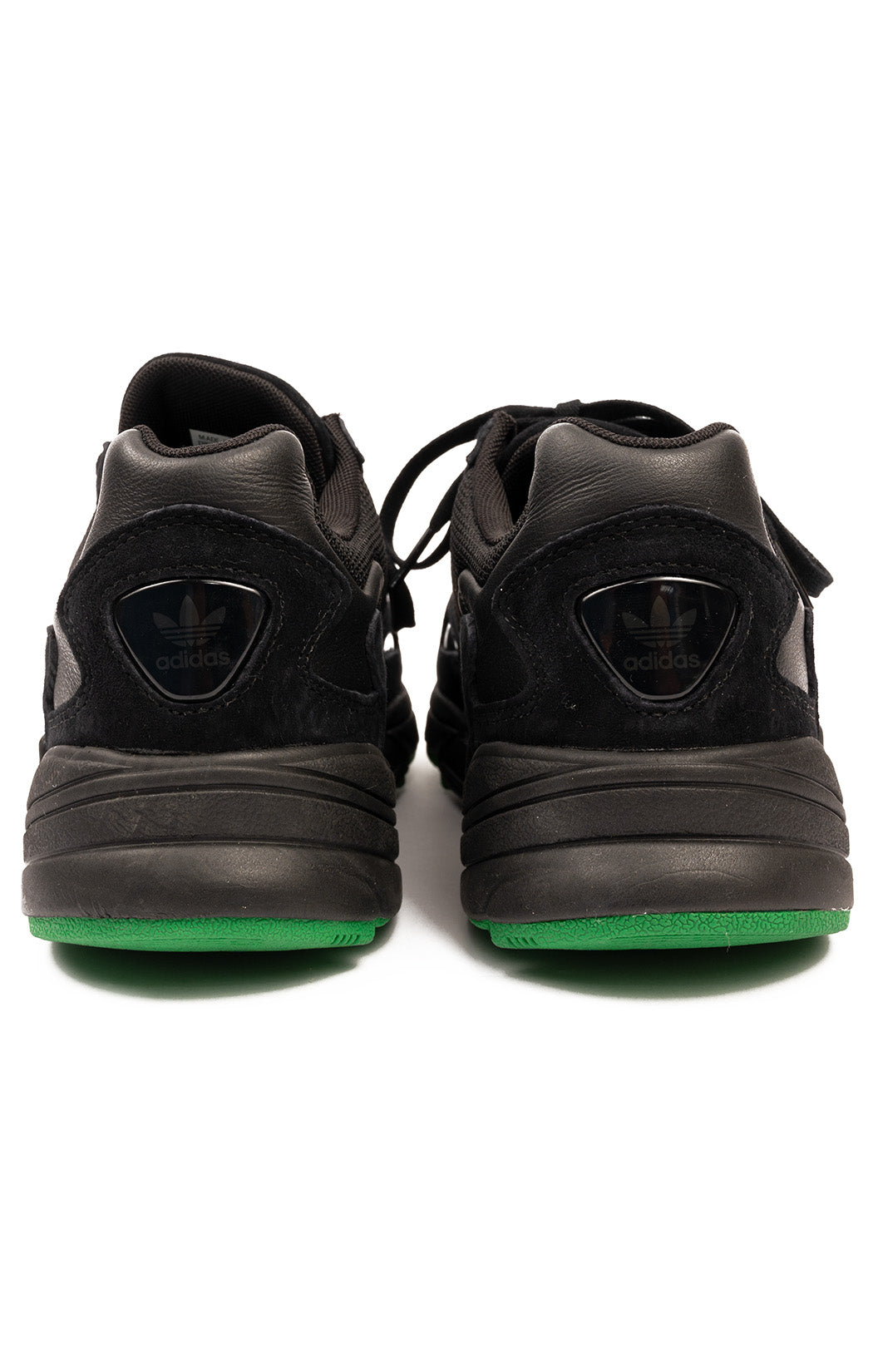Black Torsion lace-up shoe With green accent color on bottom