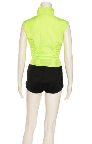 Neon green sleeveless form fitting top with front zipper and front ruching