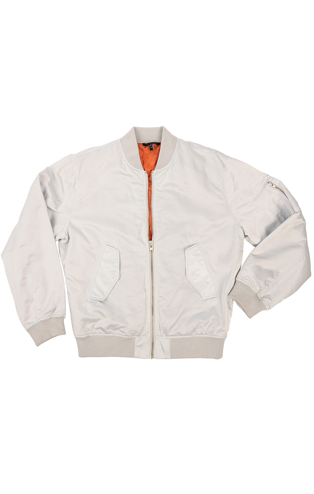 Light blue gray bomber style jacket with zipper front, front flap pockets and one side zipper on sleeve