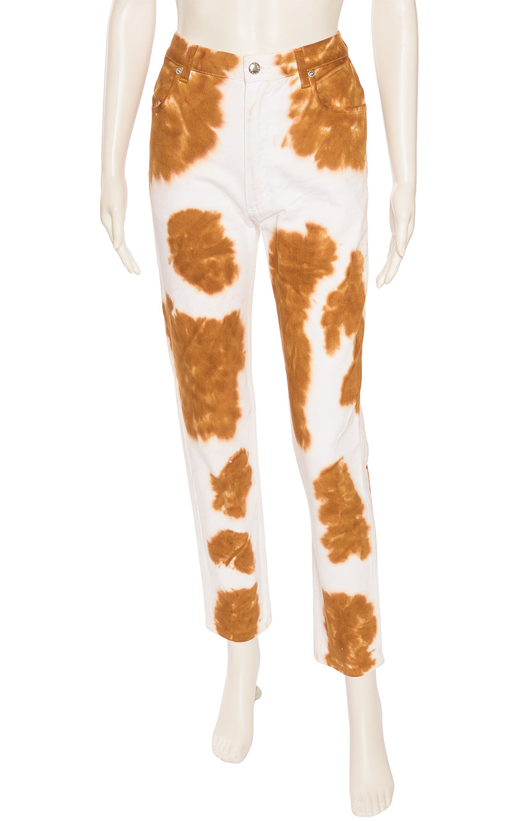 White and brown cow print five pocket style jeans with zipper front