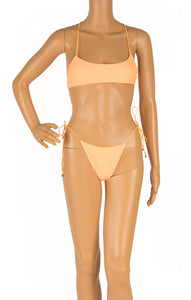 Front view of WHITE FOX with tags Bikini Size: Small