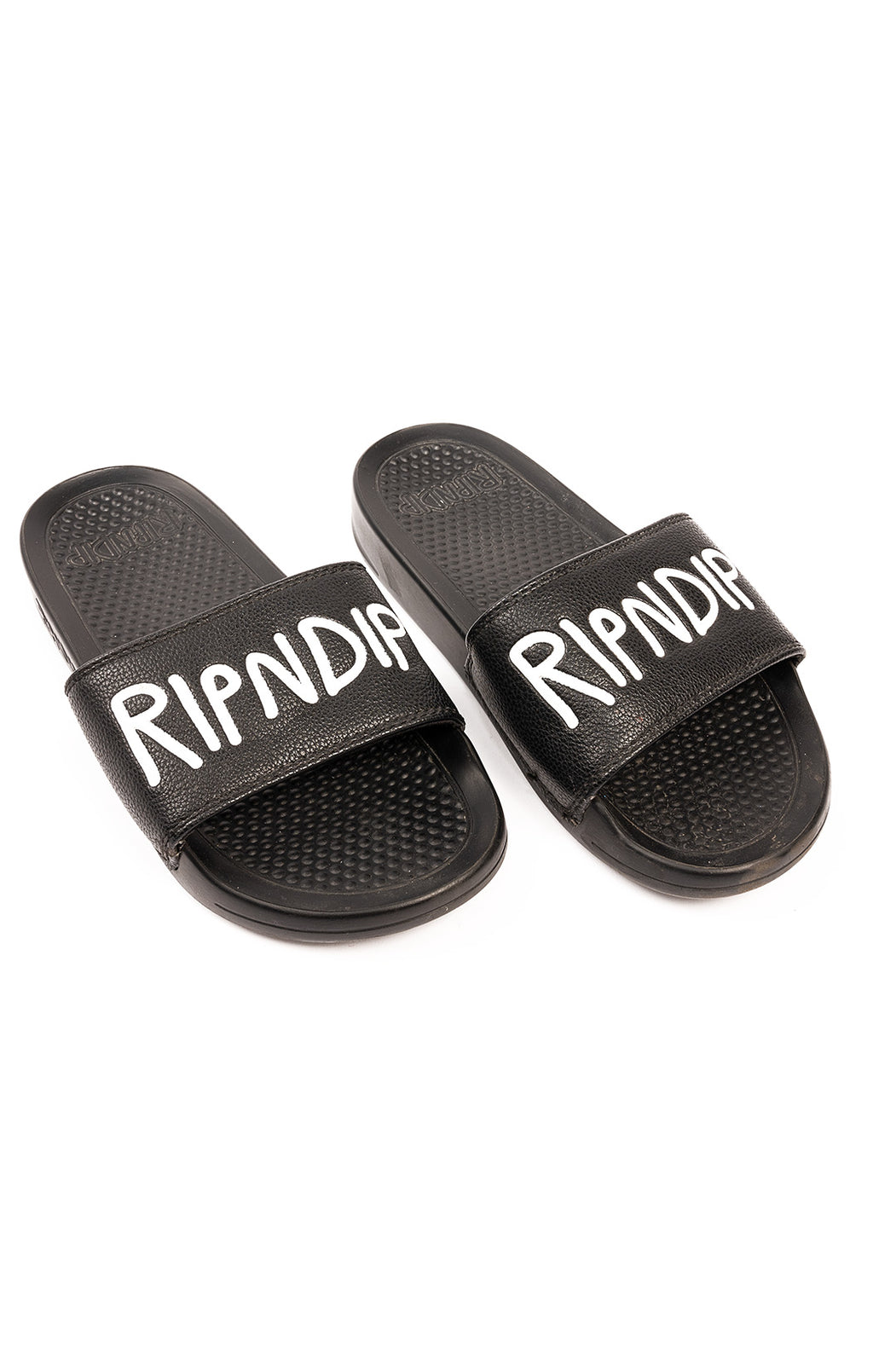 Black rubber slides with white writing