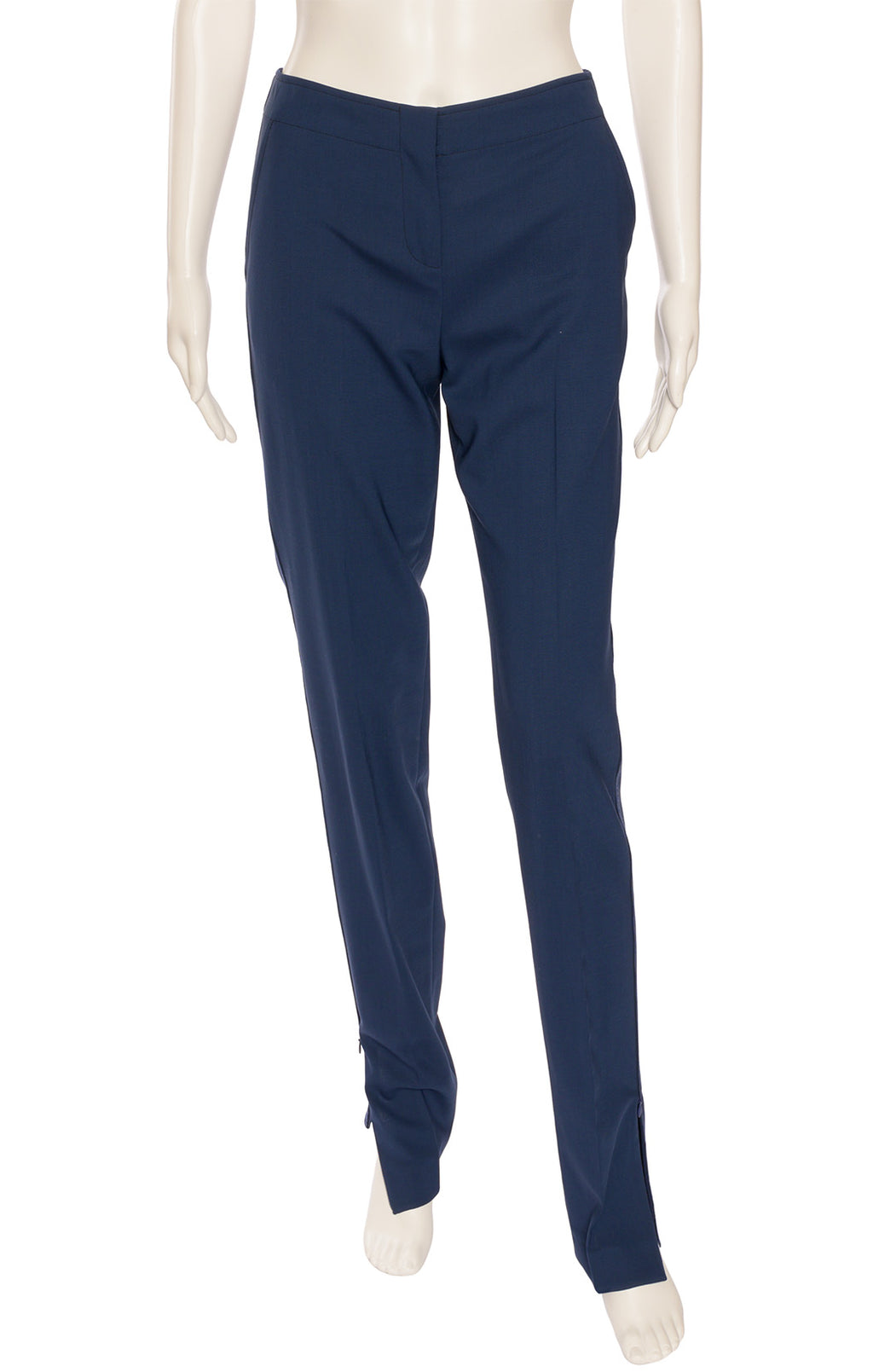 Midnight blue skinny stouter pant style with side pockets, slit back pockets and zippers at hemline