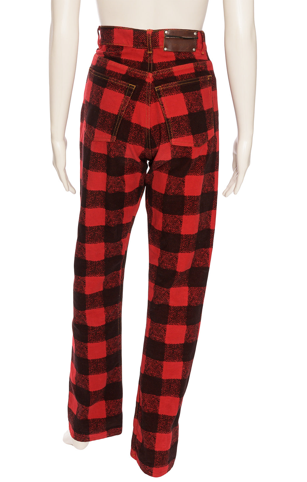 Red plaid five pocket jean style pants; fabric has velvet feel with button front closure