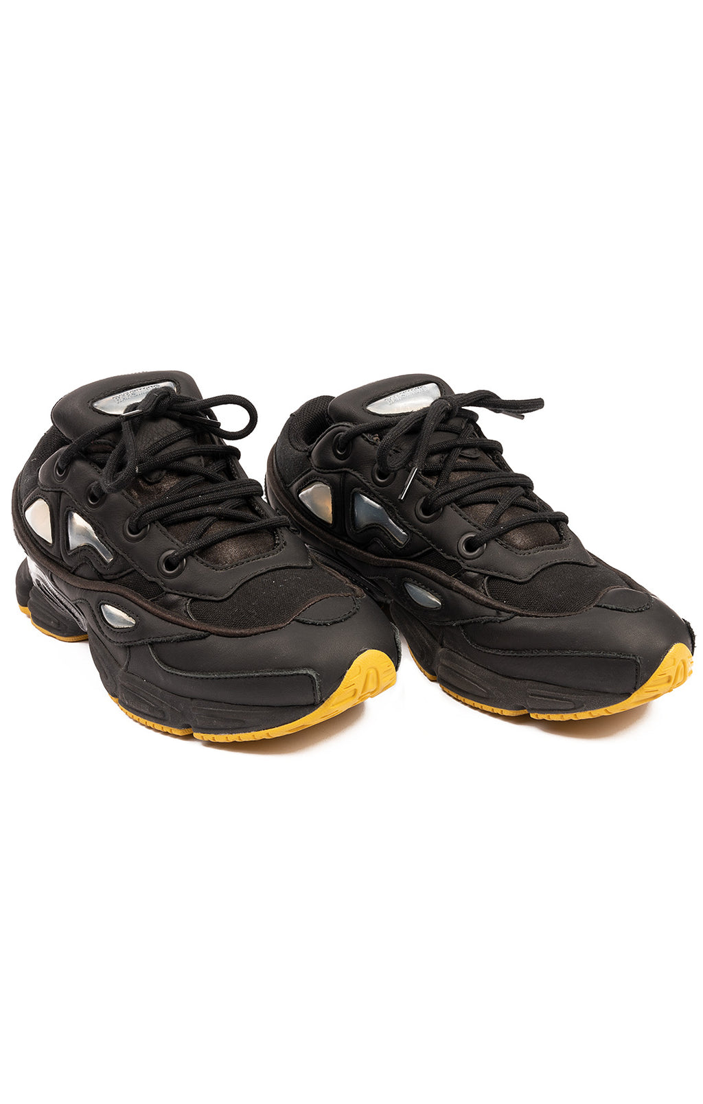 Black gray and yellow leather and fabric lace up tennis shoes
