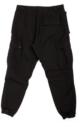 Black cargo pant with side and knee pockets with zippers at bottom hemline