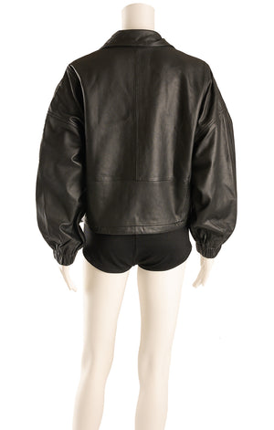 Back view of MNG with tags Leather jacket