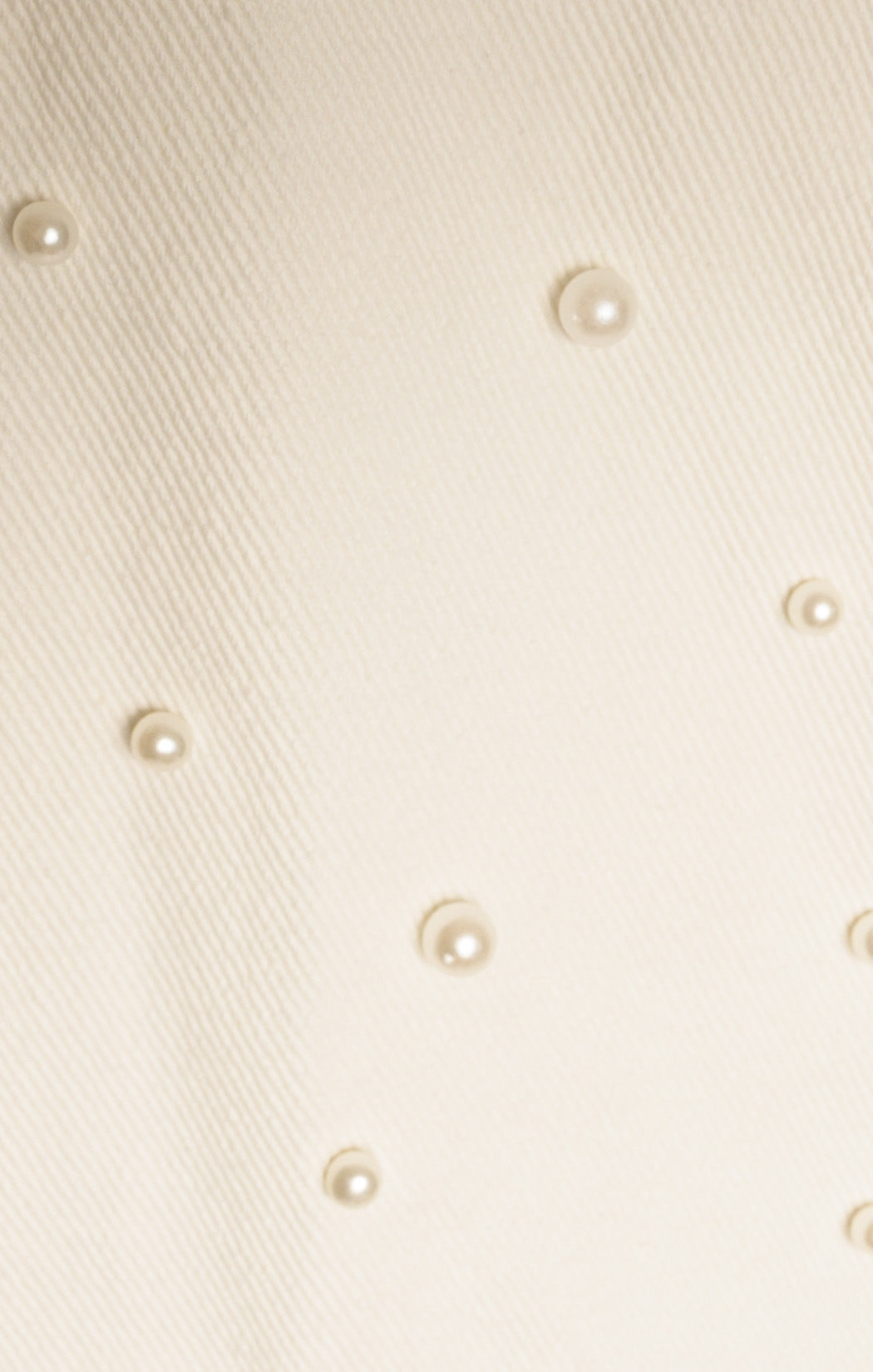Closeup of pearls on SUPERDOWN with tags Jacket