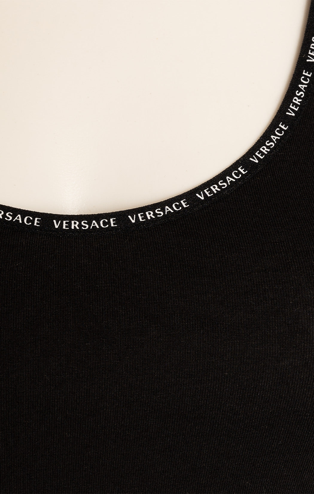 Black with white Versace logo border top and matching panty