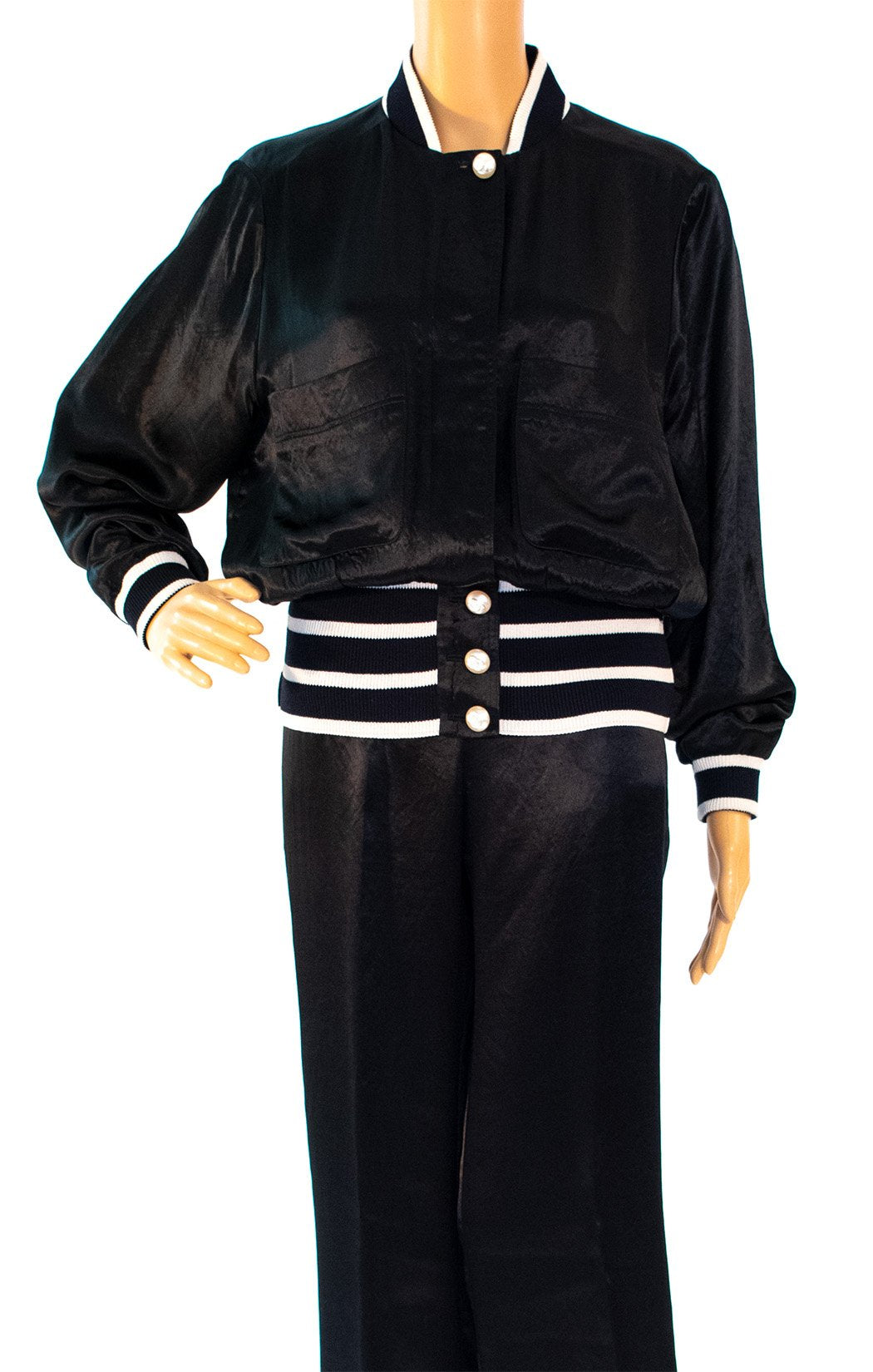 Closeup of CHANEL Track/sweat/pant suit Size: Jacket FR 36 (comparable to US 4) Pant 44 (comparable to US 12)