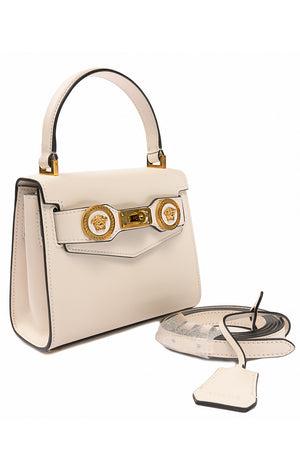 Side view of VERSACE with tags Purse shown with shoulder strap