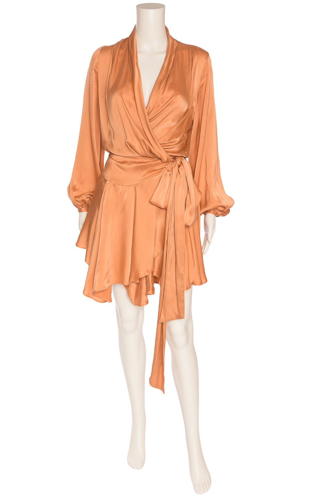 Peach colored wrap asymmetrical dress with long sleeves