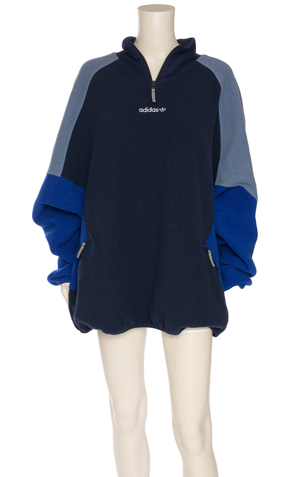 Multi-colored blue pullover polar jacket with shirt front top zipper and front zippered pockets