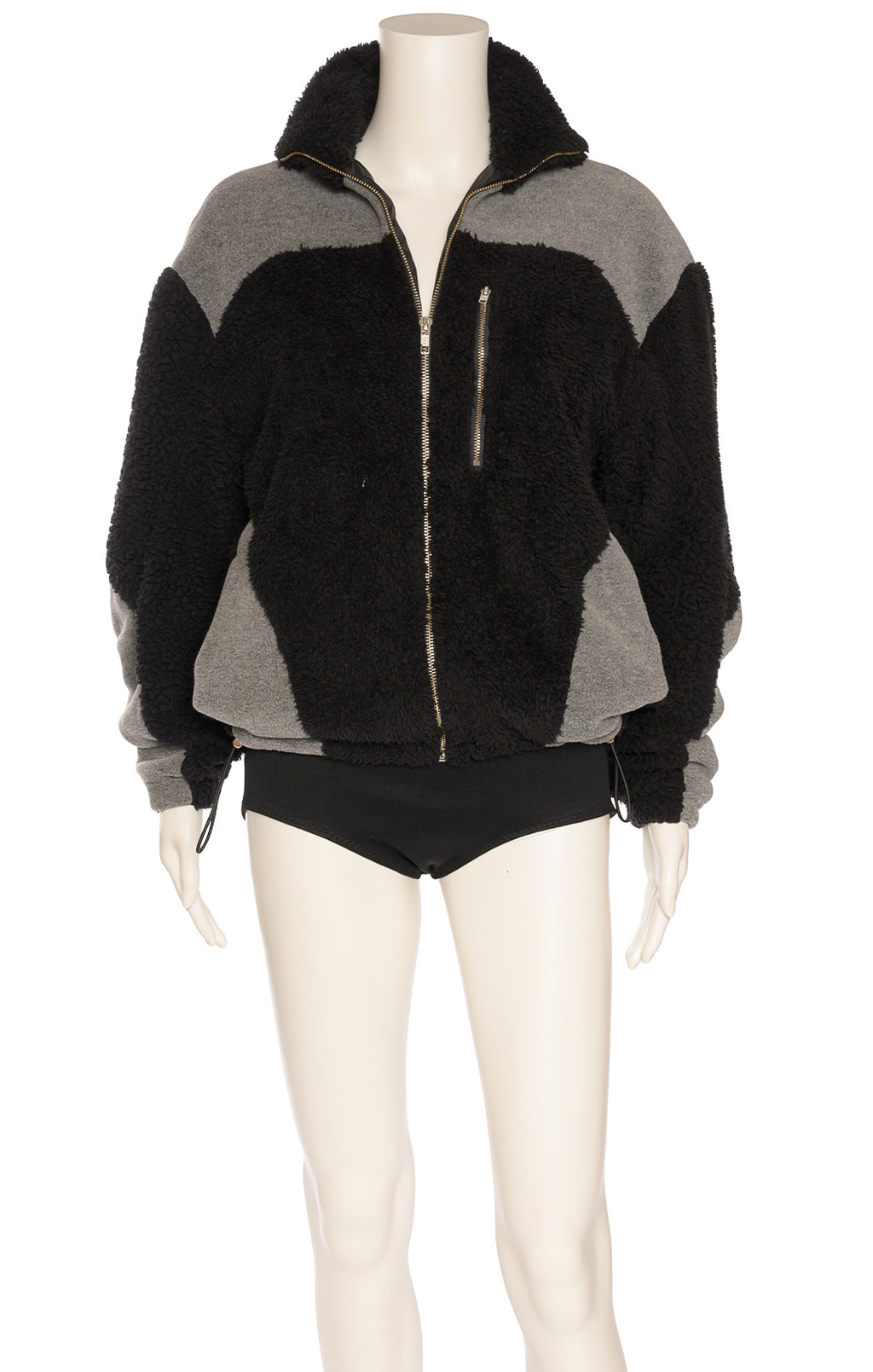 Black and gray faux fur like zippered front jacket with silver hardware and front slit zipper pocket