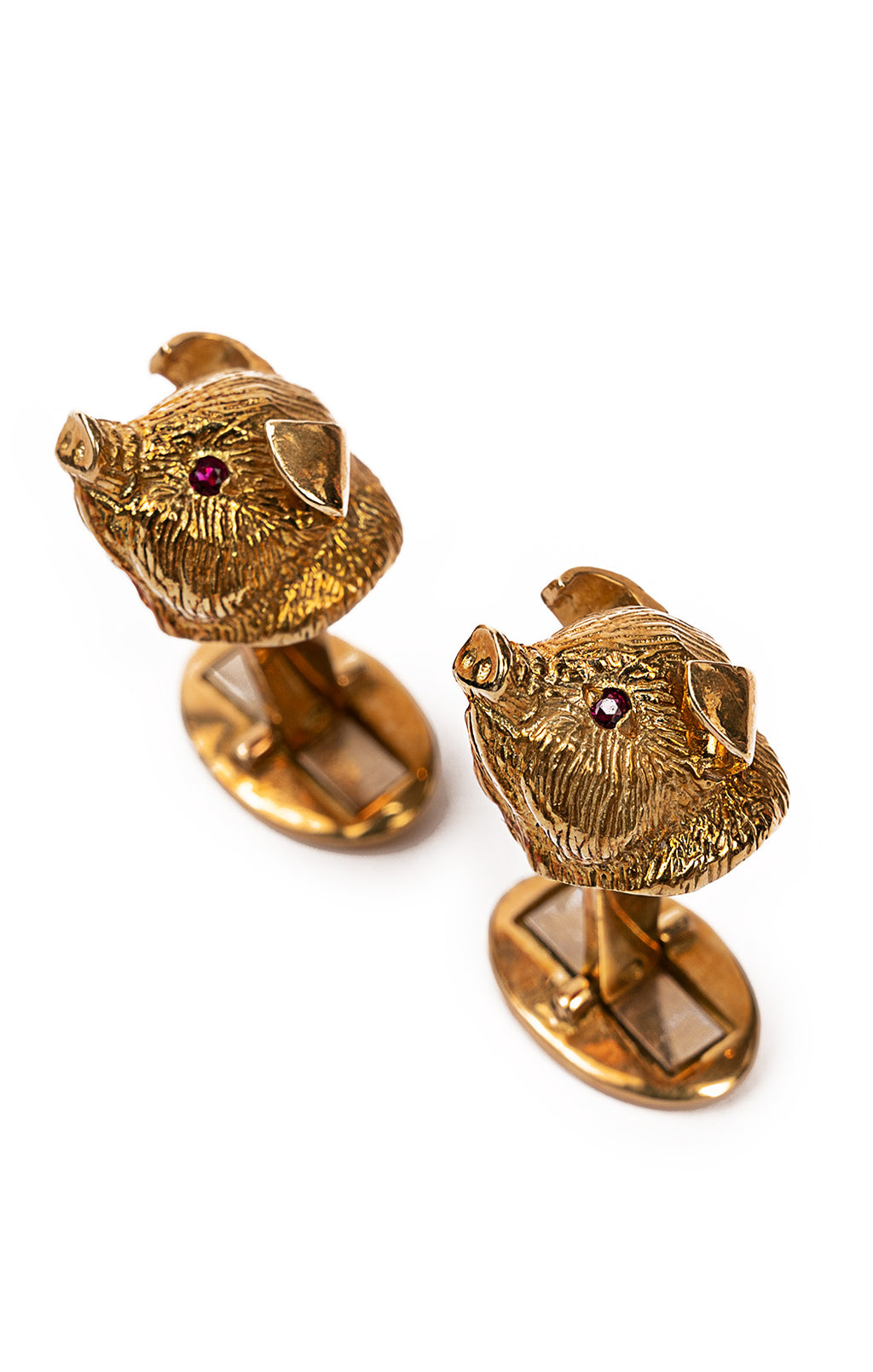 Gold textured with ruby eyes pig cufflinks