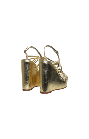 Back view of STUART WEITZMAN Gold Platform Sandal