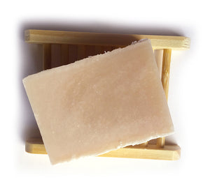 rose geranium and shea butter soap on a bamboo soap saver
