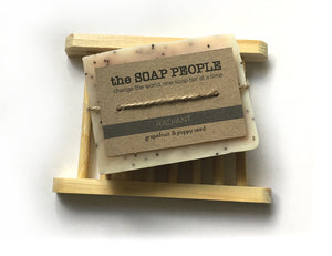grapefruit and poppy seed soap on a bamboo soap saver