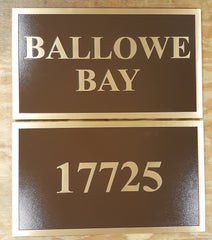 Brown Cast Bronze Signs with Single Border and Blind Stud Mounting to be mounted on twin brick entrance columns for a nearby bay home.