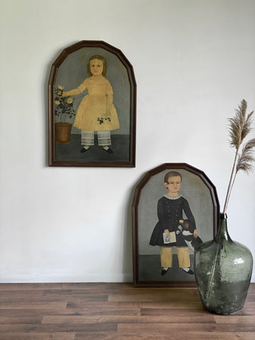 pair of framed vintage primitive folk art prints