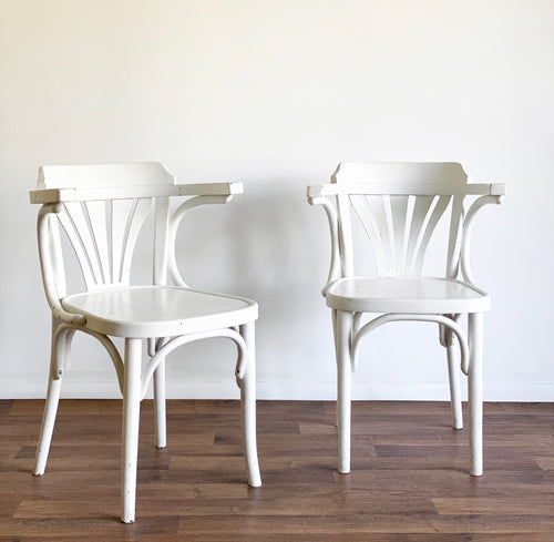 pair of vintage Thonet captain chairs