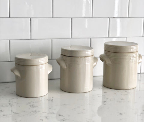set of graduated stoneware crocks