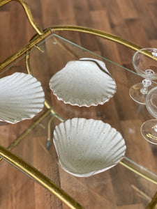 set of vintage stoneware shell dishes