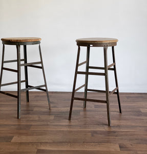 pair of vintage industrial stools