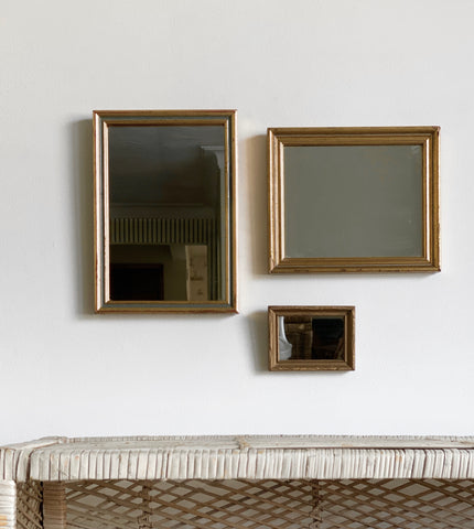 trio of vintage mirrors